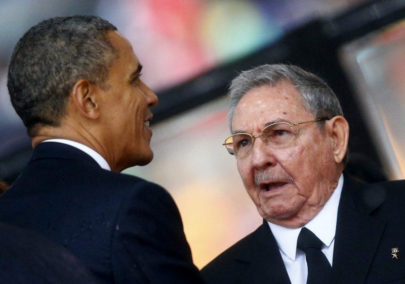US President Obama greets Cuban President Castro at the memorial service for Nelson Mandela in Johannesburg