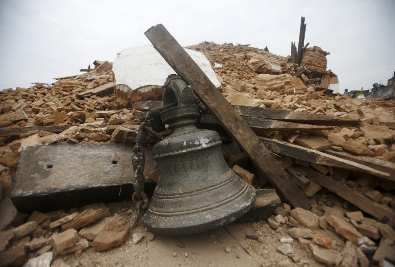 Bell of a temple lies in the debris of the collapsed temple after an earthquake, in Kathmandu