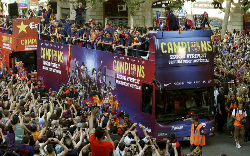 Barcelona's players celebrate from an open-top bus during celebration parade in Barcelona