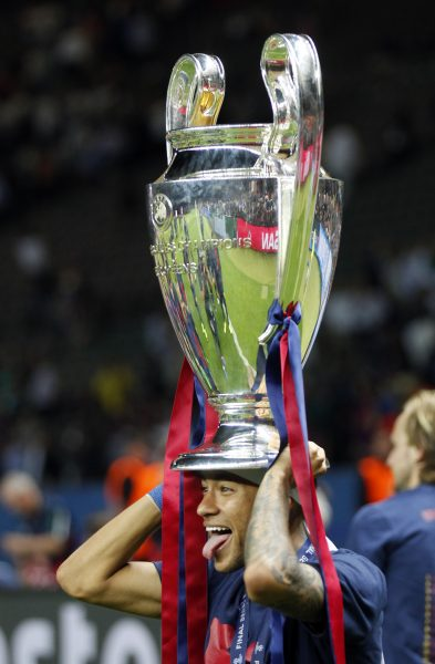 Barcelona's Neymar sticks out his tongue as he celebrates with the tr