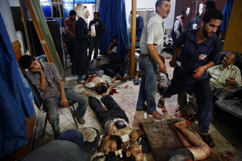 Syrian injured people receive treatment at a make-shift hospital in t