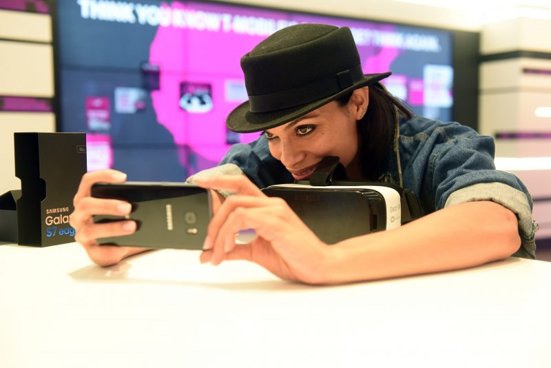 "IMAGE DISTRIBUTED FOR T-MOBILE - Rosario Dawson takes a ""selfie"" at the T-Mobile Times Square Signature Store to help celebrate the launch of the Samsung Galaxy S7, Thursday, March 10, 2016, in New York. (Diane Bondareff/Invision for T-Mobile/AP Images) T-Mobile Reality Check"
