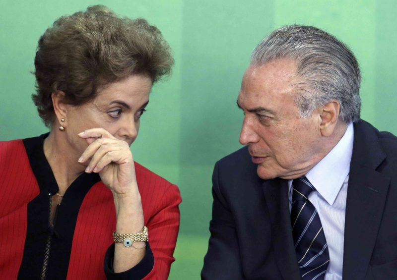 FILE - In this March 2, 2016 file photo, Brazil's President Dilma Rousseff talks with her Vice President Michel Temer at Planalto presidential palace in Brasilia, Brazil. Temer is the first in line to replace Rousseff if she's impeached, but is himself under investigation in the Petrobras corruption scandal. (AP Photo/Eraldo Peres, File)