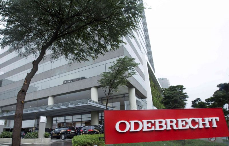 Federal police cars are parked in front of the headquarters of Odebrecht, a large private Brazilian construction firm, in Sao Paulo