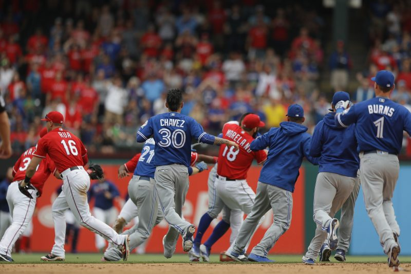 ARLINGTON, TX - MAY 15: The Toronto Blue Jays and the Texas Rangers clear the bench after Jose Bautista #19 of the Toronto Blue Jays was punched by Rougned Odor #12 of the Texas Rangers in the eighth inning at Globe Life Park in Arlington on May 15, 2016 in Arlington, Texas. Ronald Martinez/Getty Images/AFP