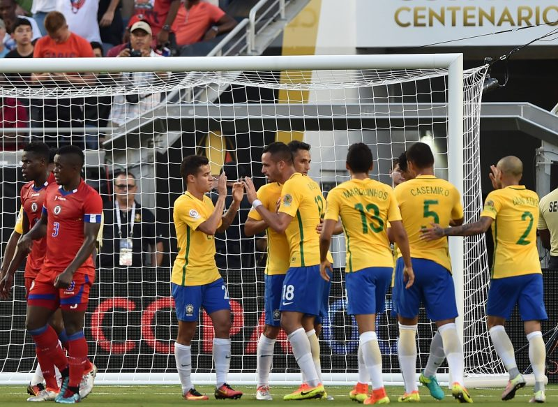 Brazil's Philippe Coutinho (3-L) celebrates with teammates a goal against Haiti during a Copa America Centenario football match in Orlando, Florida, United States, on June 8, 2016.  / AFP / Hector RETAMAL