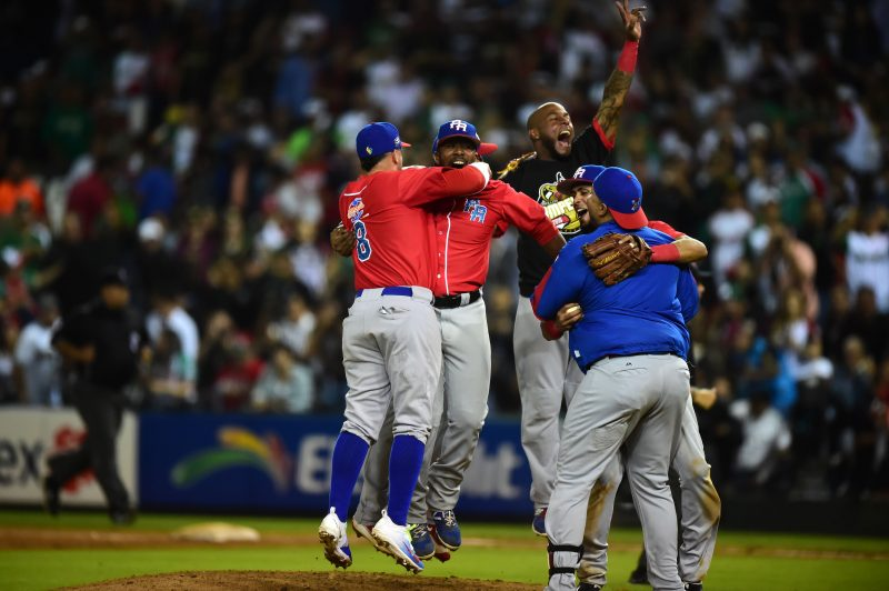 Players of Criollos de Caguas from Puerto Rico, celebrate their victory against Aguilas de Mexicali from Mexico during the final of Caribbean Baseball Series, at the Tomateros stadium, in Culiacan, Sinaloa State, Mexico, on February 7, 2017. / AFP PHOTO / RONALDO SCHEMIDT