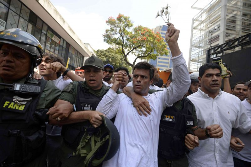 (FILE) Leopoldo Lopez (C), ardent opponent of Venezuela's socialist government, is escorted by the National Guard after turning himself in, during a demonstration in Caracas on February 18, 2014. Jailed Venezuelan opposition leader Leopoldo Lopez was sentenced to 13 years, nine months and seven days in prison, his lawyer Roberto Marrero said late September 10, 2015. The popular dissident, a US-trained economist who has been held at a military prison since February 2014, is accused of inciting violence against the government of President Nicolas Maduro and attempting to force his ouster.    AFP PHOTO / JUAN BARRETO